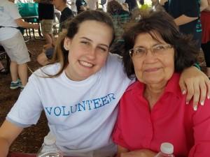 Sophia gives grandmother Vi a hug.